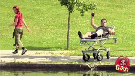 Man On Stretcher Rolls Into Lake